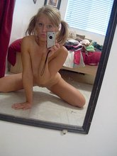 Cute cheerleader enjoys getting naked for photos