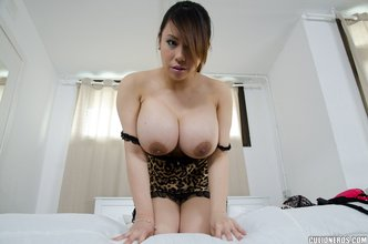 Lovely Asian GF poses with her massive tits