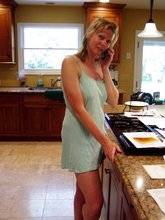 Mature girlfriend shows off her body in a kitchen