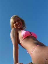 Lovely blonde exgf poses topless on a beach