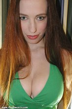 Chick in a green dress teases with her tits