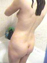 Young girl with a smooth slit showing off her goodies for you