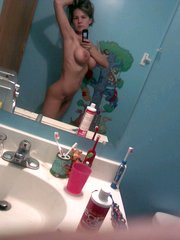 Lovely blonde GF poses naked in a bathroom