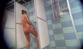 Wet beauty with a beautiful body showering in HD (voyeur porn)