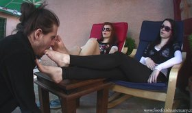 Girls with dirty feet humiliating their dedicated foot-cleaning slave