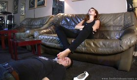 Great-looking femdom mistress gets her feet cleaned on camera