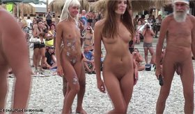Naked girls with beautiful bodies showing their pussies on a beach