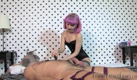 Wig-wearing mistress jerking her slave's throbbing boner here