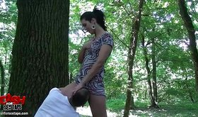 Tall horny bitch gets licked next to the tree