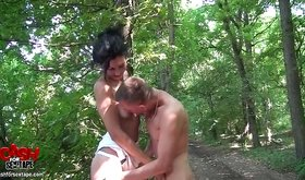 Shirtless slender babe making out outside with her partner