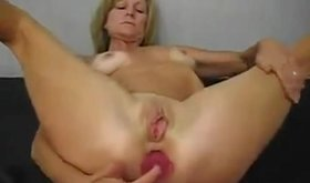 Horny blonde granny has a toy for every hole