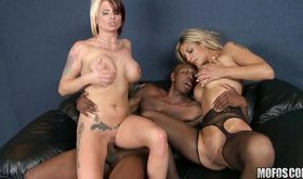 Naughty tattooed sluts giving double blowjob to black jock