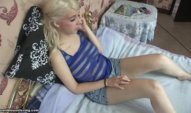 Spunky teen blonde showing off her tiny tits here