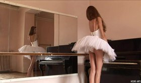Very skinny ballerina posing in her dress