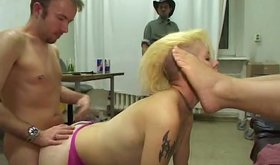 Three males dominate a blonde lady and golden shower her