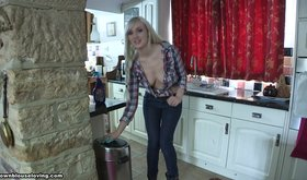 Leggy blonde being naughty in the kitchen