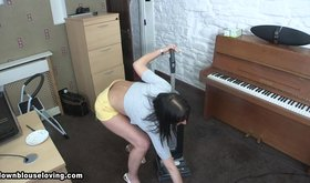 Skirt-wearing amateur girlfriend vacuuming and teasing