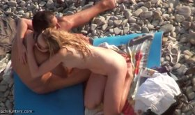 Amateur blonde hugging her boyfriend on beach