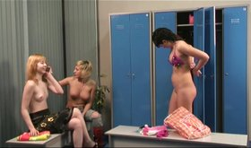Three girls chatting in the dressing room while half-naked
